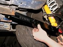 0811gmhtp_07_z Chevy_camaro_z28_bmr_adjustable_torque_arm_install Installing_front_bmr_lca