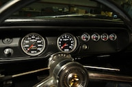 1965 chevelle gauges at night