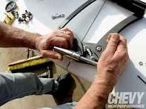 1005chp_08_o Billet_hood_hinges_install Gas_tube_shock