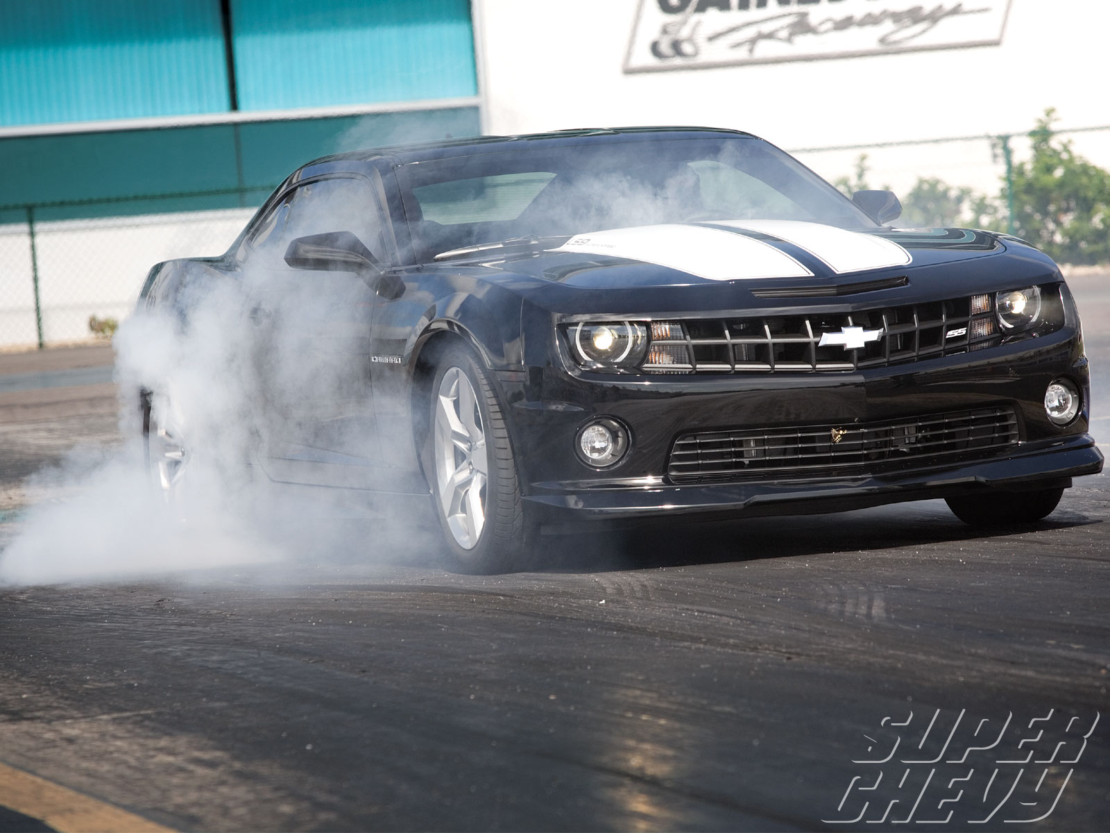 Sucp_1102_01_o Nesmith_storm_chevrolet_camaro_ls9 Passenger_side_front_burnout_view