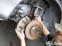1011gmhtp_05_o Cadillac_cts_v_brembo_brakes_nitto_tires_wheels Removing_caliper