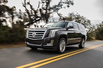 2015 Cadillac Escalade Front Three Quarters In Motion