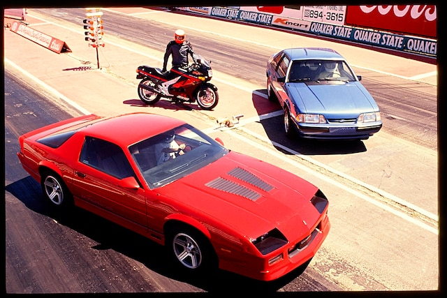 1990 chevrolet camaro iroc z against a 5 0l ford mustang lx super chevy